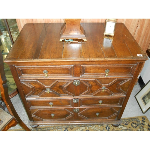 58 - A Jacobean style oak chest fitted two narrow and three wide drawers with moulded decoration, on turn...