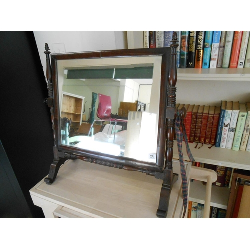 24 - A mahogany framed swing toilet mirror with turned supports and a pair of bevelled wall mirrors with ...