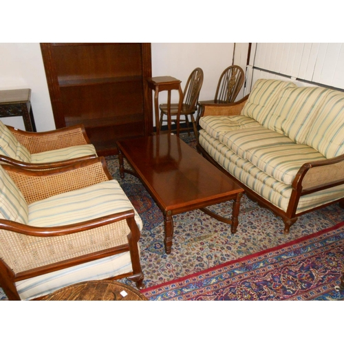 49 - A three piece walnut and cane Bergere suite comprising:- settee and two armchairs with loose seat an...
