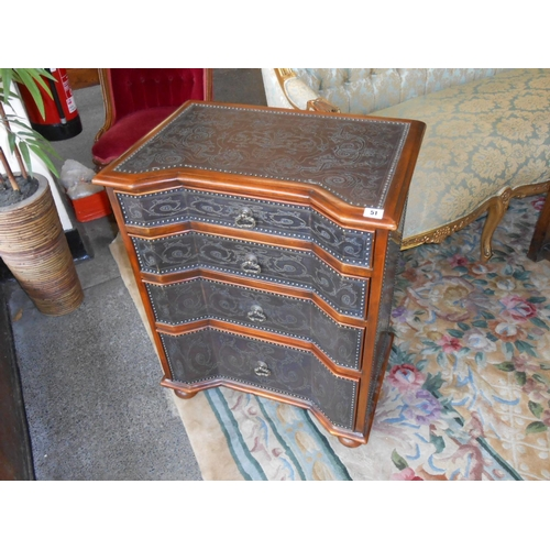 51 - A reproduction walnut chest with concave front, metal top, sides and drawer fronts with urns of flow...