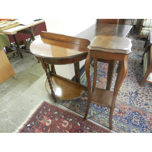 59 - An oak sidetable with low raised back, bow front, on barley twist legs united by undertier - 30in. w...