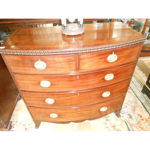 43 - A Georgian mahogany bow front chest fitted two narrow and three wide drawers, nulled edge, on splaye...