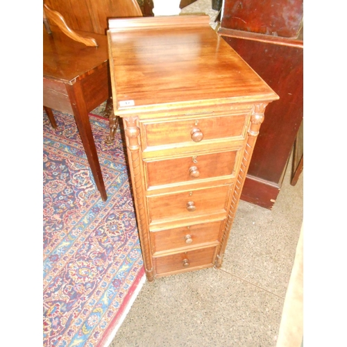 47 - A Victorian mahogany narrow chest fitted five drawers, fluted pilasters, on bun feet - 16in. wide...
