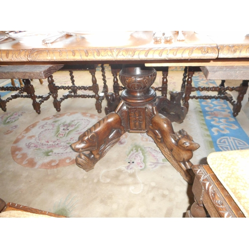 53 - A Victorian oak dining table with square top, five extra centre leaves, on heavy carved bulbous cent...