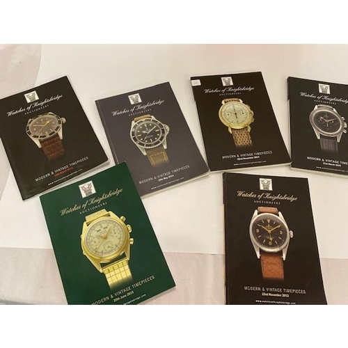42 - A quantity of books on Rolex, carriage clocks, pocket watches, auction catalogues etc.....