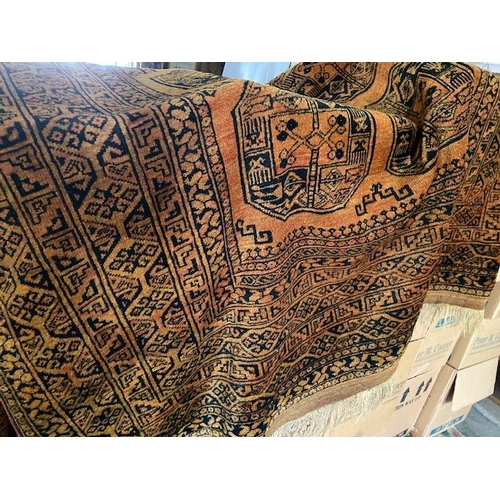 1 - A Golden Afghan rug, yellow field with black stylised guls to the centre, fringed - 120in. x 80in....