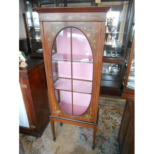 46 - An Edwardian satinwood display cabinet painted with roses and leaf swags, oval glass panelled door e...