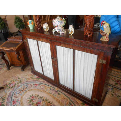 55 - A 19th Century mahogany bookcase fitted two glass doors enclosing shelves, on platform base - 72in. ...
