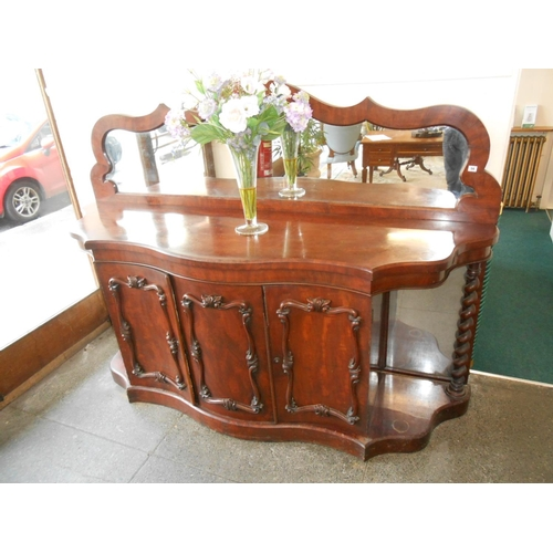 56 - A Victorian mahogany buffet, the raised shaped back inset mirror, the base fitted three doors with m...