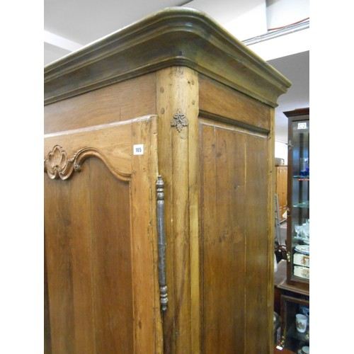 32 - A French walnut armoire fitted shaped panelled door, on bun feet - 36in. wide