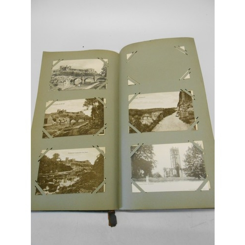 16 - A postcard album containing black and white cards depicting cathedrals and churches etc..