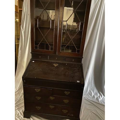 27 - A Georgian oak bureau bookcase, the upper part fitted two glass doors with geometric glazing bars ab...