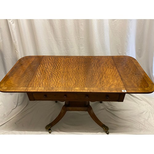 28 - A Regency satinwood and kingwood crossbanded sofa table fitted two drop flaps, two frieze drawers, o...