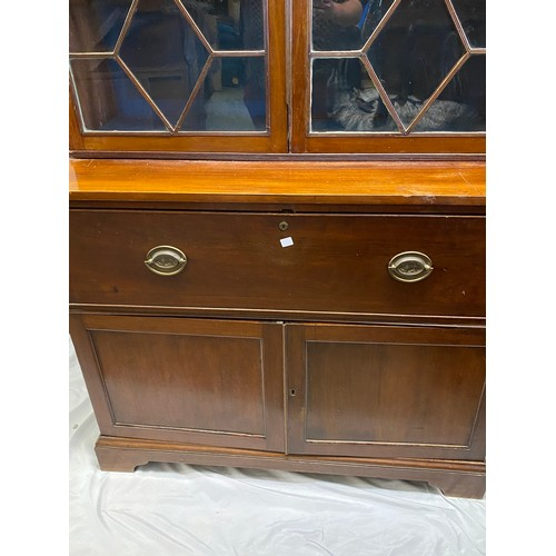 33 - A Georgian mahogany bookcase, the upper part fitted two glass doors with geometric glazing bars, the...