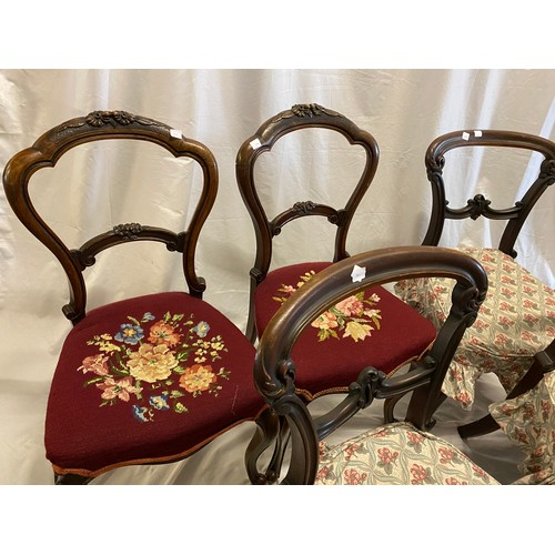 34 - A set of four Victorian stained beech framed dining chairs with shaped backs, scrolling centre splat...