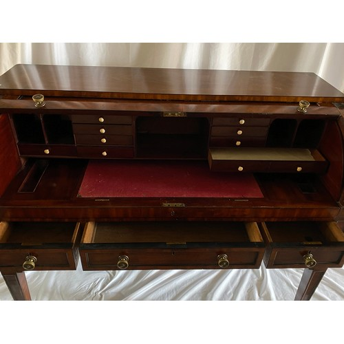 42 - A Georgian mahogany and ebony line inlaid cylinder front bureau, the roll front enclosing sliding wr...