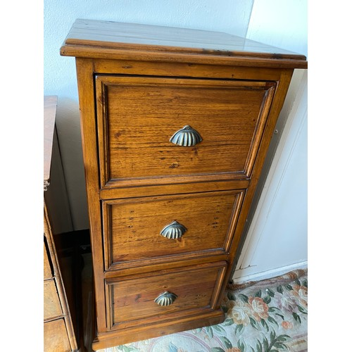 61 - A stained pine filing cabinet fitted three drawers - 22 1/2in. wide