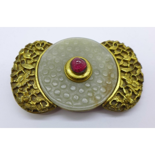 828 - An 18th Century Indian gilt metal buckle set with jade and ruby...