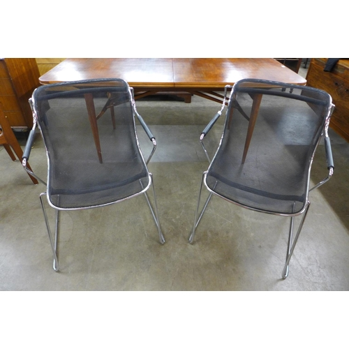 146 - A pair of Charles Pollock Penelope chrome and black mesh chairs...