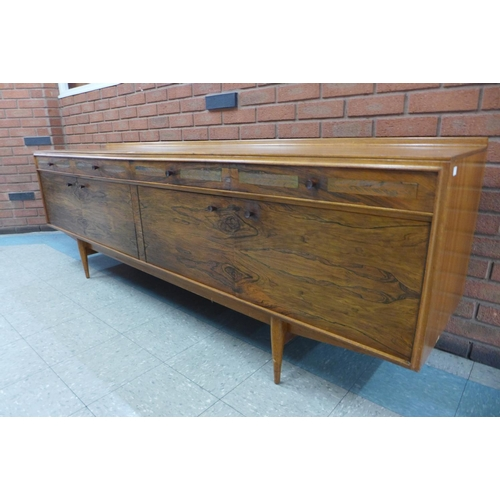 147 - An Archie Shine rosewood and teak sideboard, designed by Robert Heritage, 79cms h, 229cms w, 51cms d...