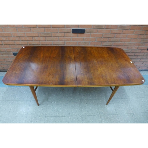 148 - An Archie Shine rosewood and teak extending dining table, 72cms h, 182cms l, 82cms w,   * Accompanie...