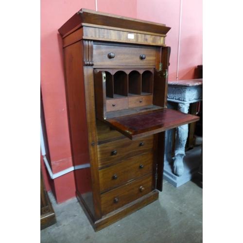 87 - A Victorian mahogany secretaire Wellington chest...