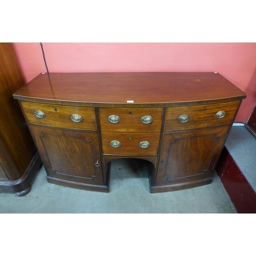 53 - A George IV mahogany bow front sideboard...