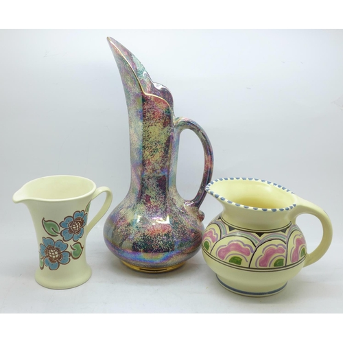 610 - Two Honiton pottery jugs and a Govancroft of Glasgow lustre jug...