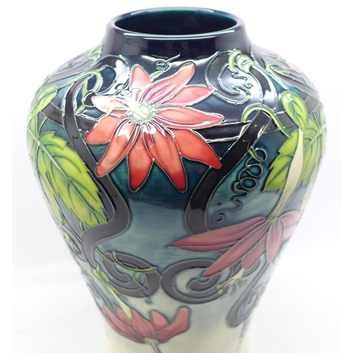 612 - A Moorcroft Scarlet Star limited edition vase, designed by Anj Davenport, dated 2001, numbered 26/30...