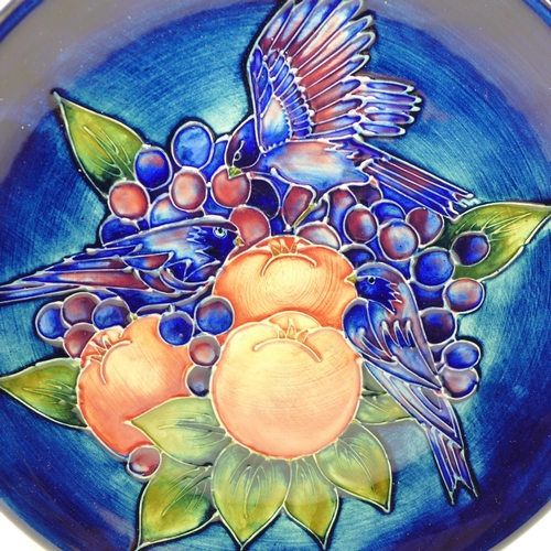 614 - A Moorcroft Finches plate, on a blue ground, 26cm, boxed...