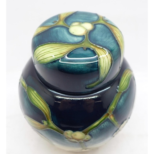 617 - A Moorcroft Mistletoe ginger jar, designed by Anji Davenport, (only available  December 2001) 11.5cm...