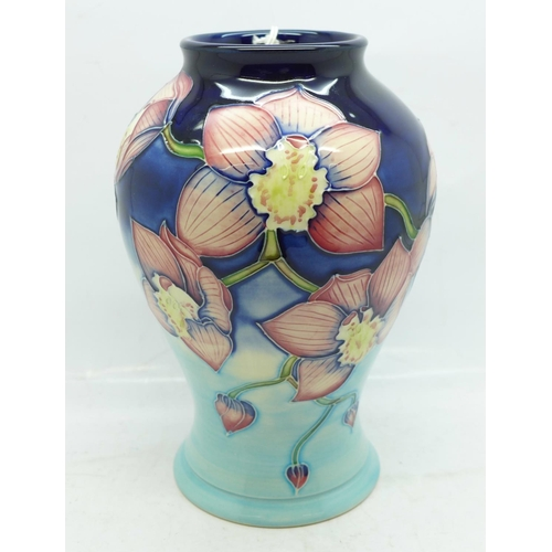 620 - A Moorcroft Cymbidium limited edition vase, designed by Anji Davenport, dated 2001, numbered 21/30, ...