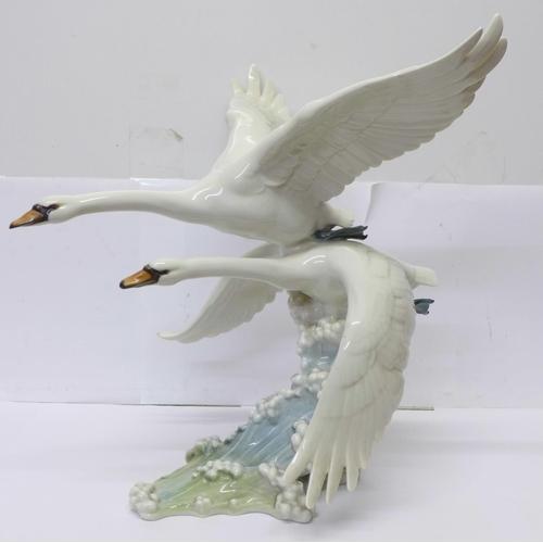 622 - A Hutschenreuther swan figure group, 33cm...