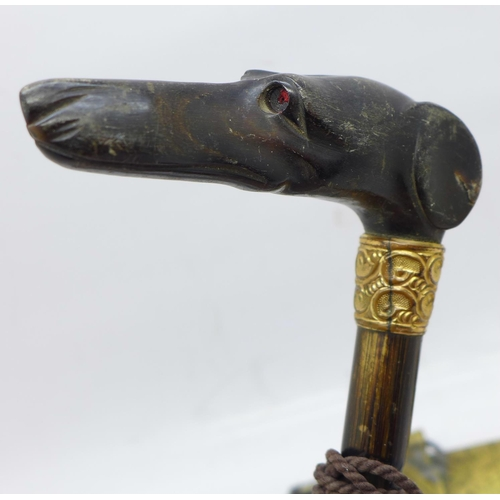 624 - An inlaid Jambyia dagger, a Swedish knife and a carved horn umbrella handle in the form of a greyhou...