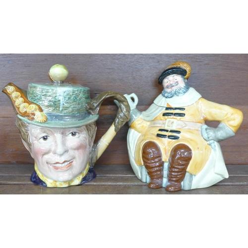 628 - A Beswick and a Royal Doulton character teapot and three Beswick character mugs...