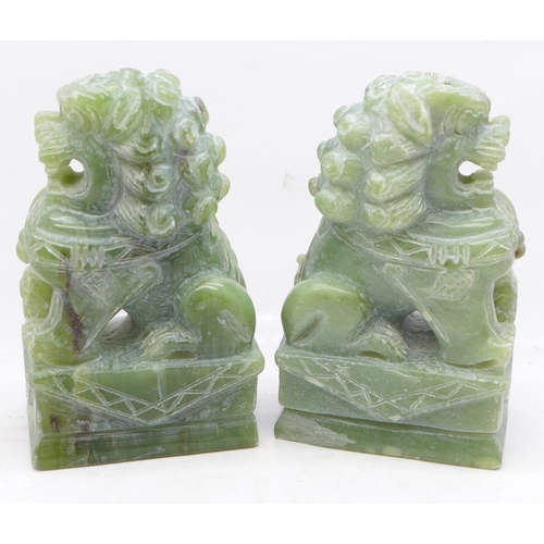 630 - Two carved jade dogs of foe, 12cm...