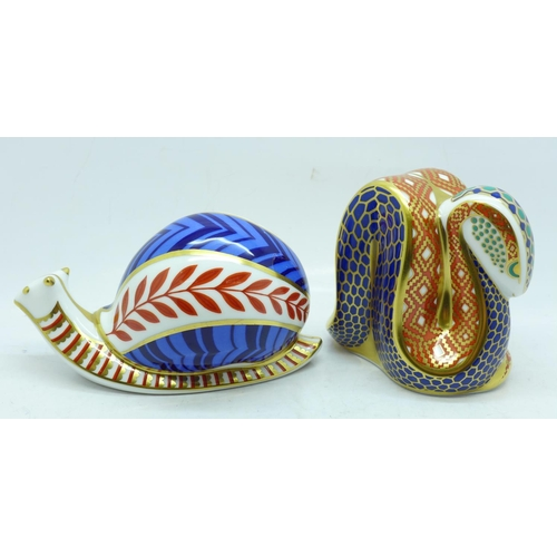 632 - Two Royal Crown Derby paperweights, Snake and Snail, Snake with gold stopper...