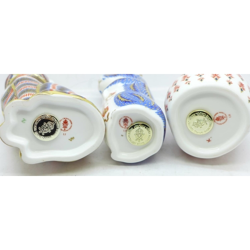 633 - Three Royal Crown Derby paperweights, two with gold stoppers and cat with silver stopper...