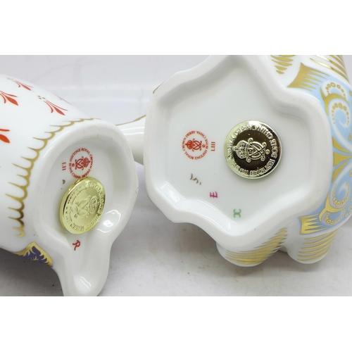 634 - Two Royal Crown Derby paperweights, Dolphin and Penguin, Penguin with gold stopper...