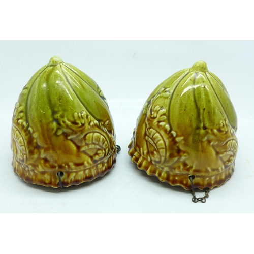 637 - A pair of Victorian majolica hanging planters...