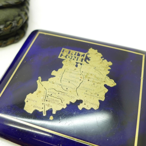 652 - A beaded purse, a cigarette case with German British zone map, two compacts and coin purse...