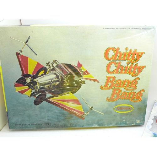 654 - A Chitty Chitty Bang Bang poster, an Aurora model kit, a Corgi Toys model, a/f, and one other later ...