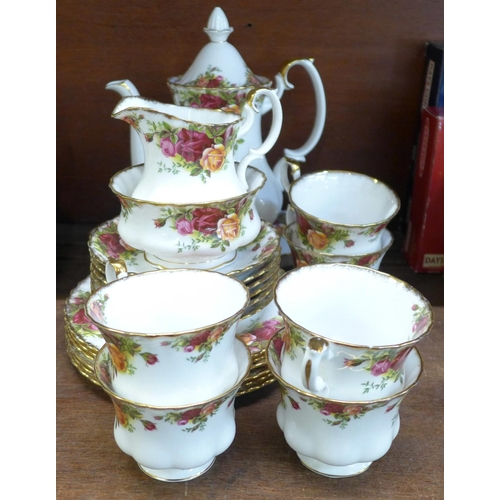 659 - A Royal Albert Old Country Roses coffee set with six cups and saucers, cream, sugar, side plates and...