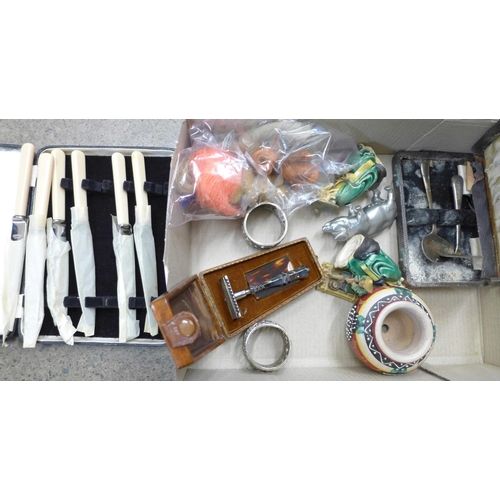 708 - A box of assorted items including Trolls, a razor, christening set, knives, oriental figures, a/f, e...