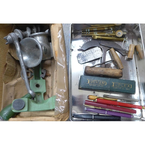 709 - Two brass glass cutters, hair trimmer, pens, pencils, mincer, etc....