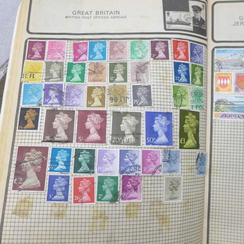 710 - A folder of stamps; four albums and loose...