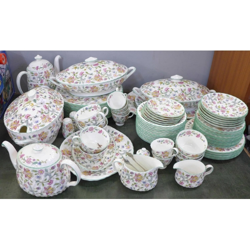 754 - A large collection of Minton Haddon Hall tea and dinnerware, including three large tureens, teapot, ...