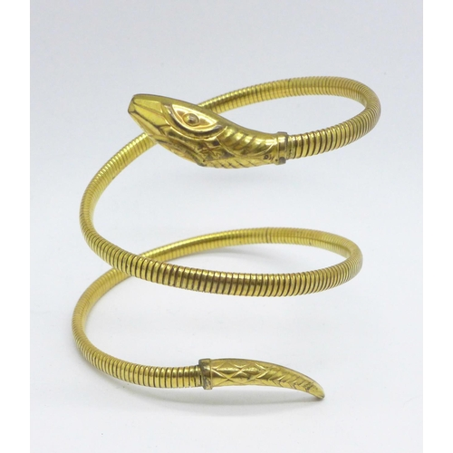 963 - A rolled gold snake bangle...