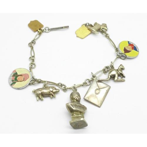 966 - A charm bracelet...