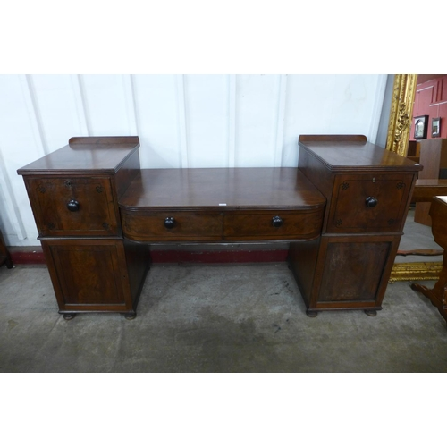 41 - A Regency inlaid mahogany breakfront serving table...